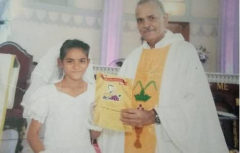 Fatima Arzoo the day of her first Holy Communion